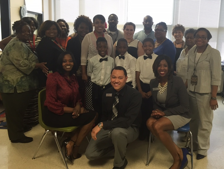 Business Development Officer Trevia Chatman (seated L), Branch Manager Joseph Peters (front C), and Michelle Turner (seated R) with the staff and students of Cromwell.