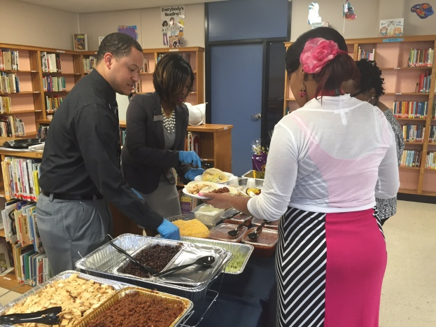 Branch Manager Joseph Peters (L) and Michelle Turner (C) host and serve lunch to Cromwell's teachers.