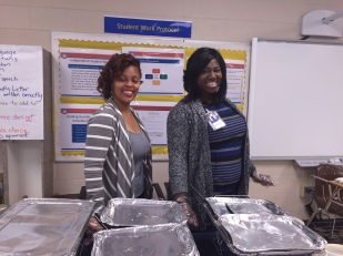 Business Development Representative DeMia Mays (L) and Assistant Branch Manager Renelle Valentine (R) prepare to serve lunch to the teachers.