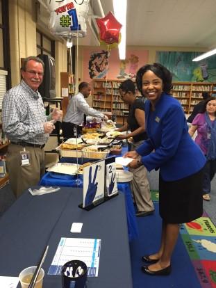 Richard Vassallo (front R) and school principal Patrice Shipp (front L) at Orion's lunch celebrating Delano's SCORE Award.