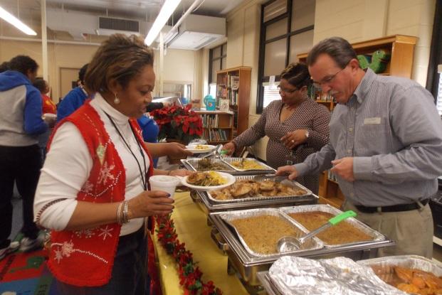 Richard Vassallo (front R), and Gwen Golliday (R) serving Cromwell's Teacher Appreciation lunch.