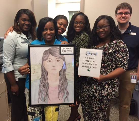 Our White Station Branch team with student artwork, displayed in their branch throughout the month of May.