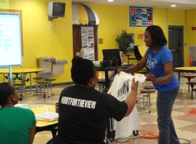 Orion BDO, Trevia Chatman (right) distributes tees to Havenview's teachers