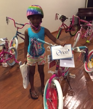 Winner of the participant drawing for a new bike and safety helmet! SCS Back to School Family Affair, with LeBonheur Safe Kids Mid-South